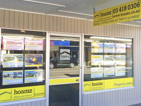 Next Produce under-veranda sign and vinyl graphics to windows and door