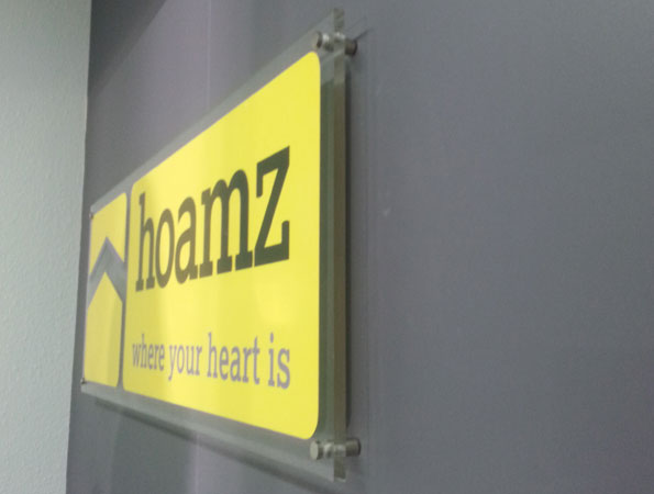 Produce glass signs for Hoamz Office