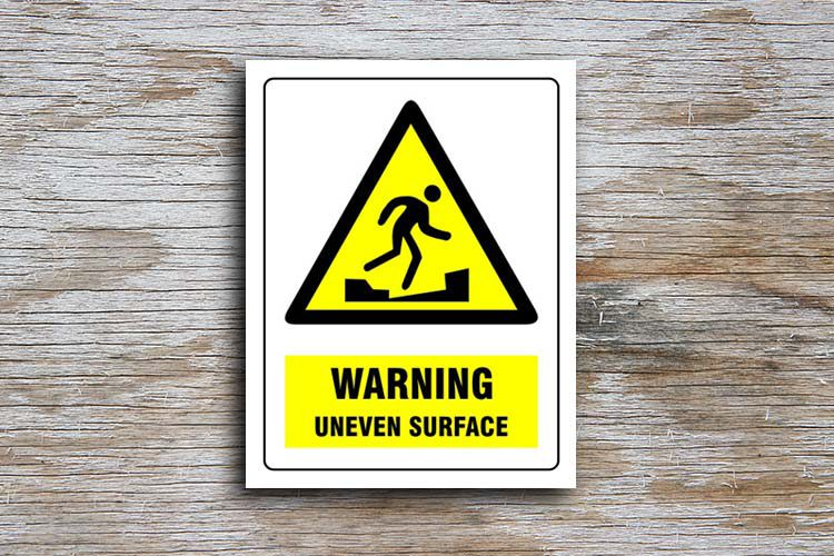 Uneven Surface Warning Sign