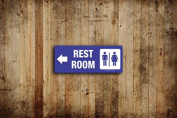 Restroom signs with left arrow